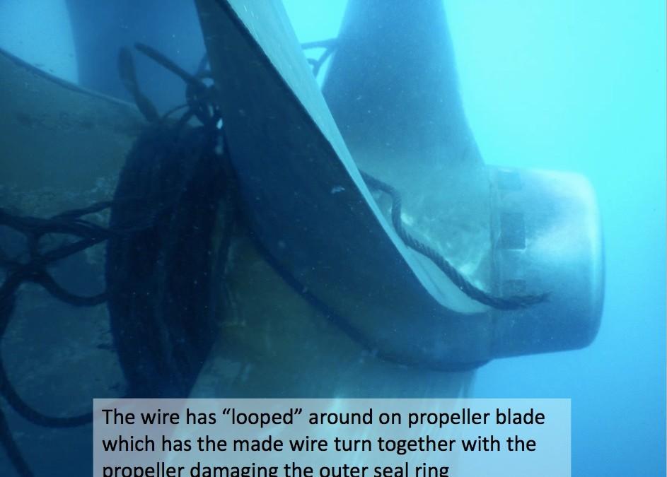 Wire looped around propeller blade
